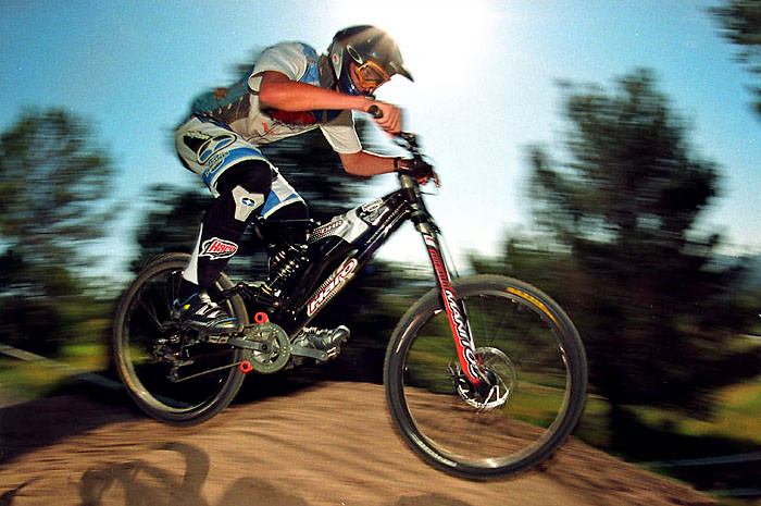 Greg aboard his Intense-built Haro DH bike that he used to win World Champs, Sea Otter '03. photo by gordo