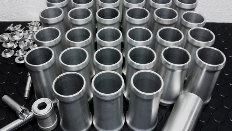 A new batch of headtubes waiting to be partnered with the rest of the frame.