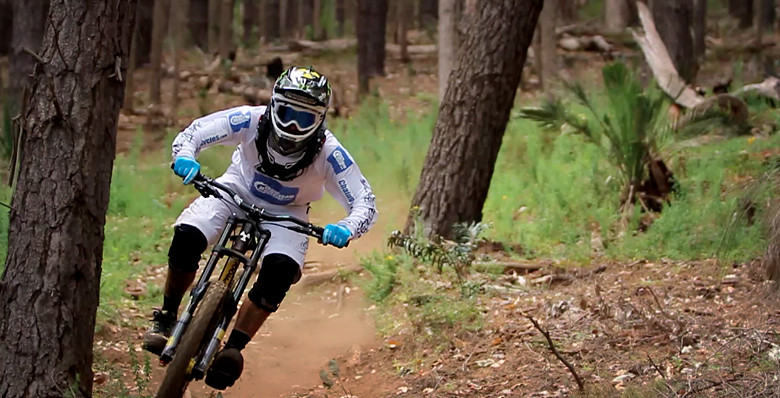 Sam Hill on a SRAM-equipped 2012 Nukeproof Pulse team frame. He's not wearing the 2013 team kit. He's in pre-season Troy Lee gear.