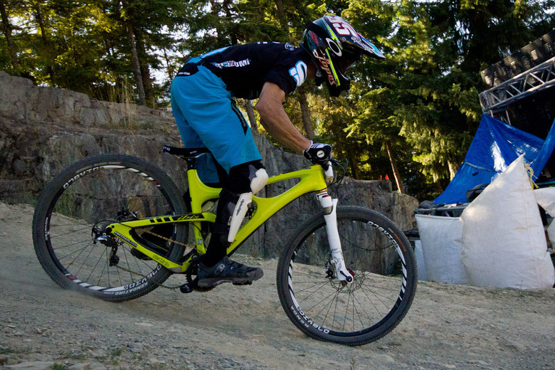 Brian Lopes giving his Ibis Mojo a good spanking off the GLC drop at the Crankworx Air DH 2012.