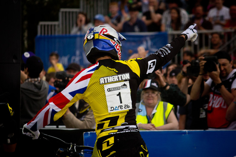 A victorious Gee Atherton points to the crowd - Photos by Brandon Turman