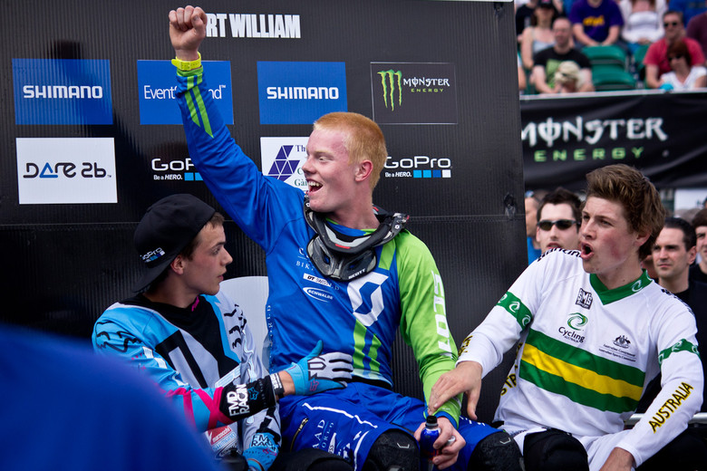 Noel Niederberger celebrates his Junior downhill victory at Fort William from the hot seat.
