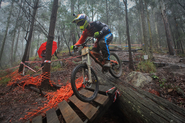 Photo: Deubel Bicycles - Graeme Mudd on track at Awaba, mastering the challenging wet conditions well.