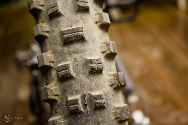 The tears in the treads blocks go almost to the base of the tread and continue around the tire.