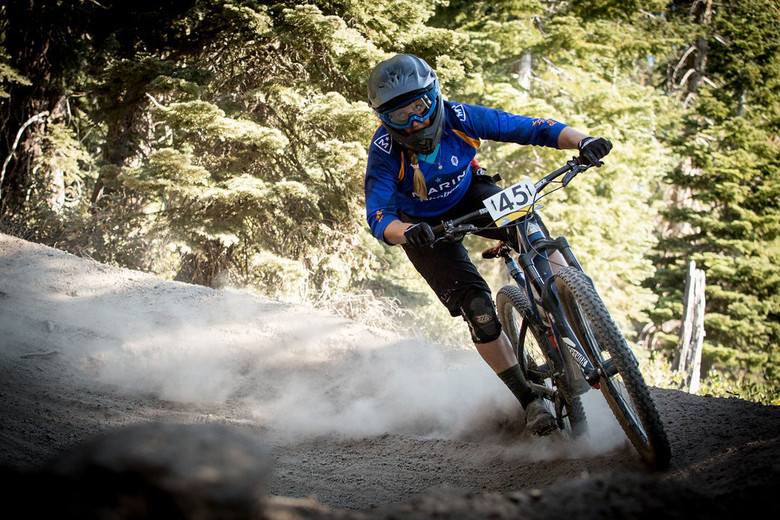 Amy Morrison, 2nd place in Pro Women, shreds the brown powder in a berm on stage 1.