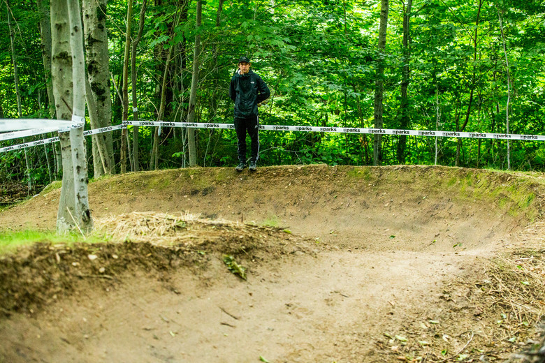 Tanner Stephens takes a gander at the two monster berms before exiting the woods out towards the finish.