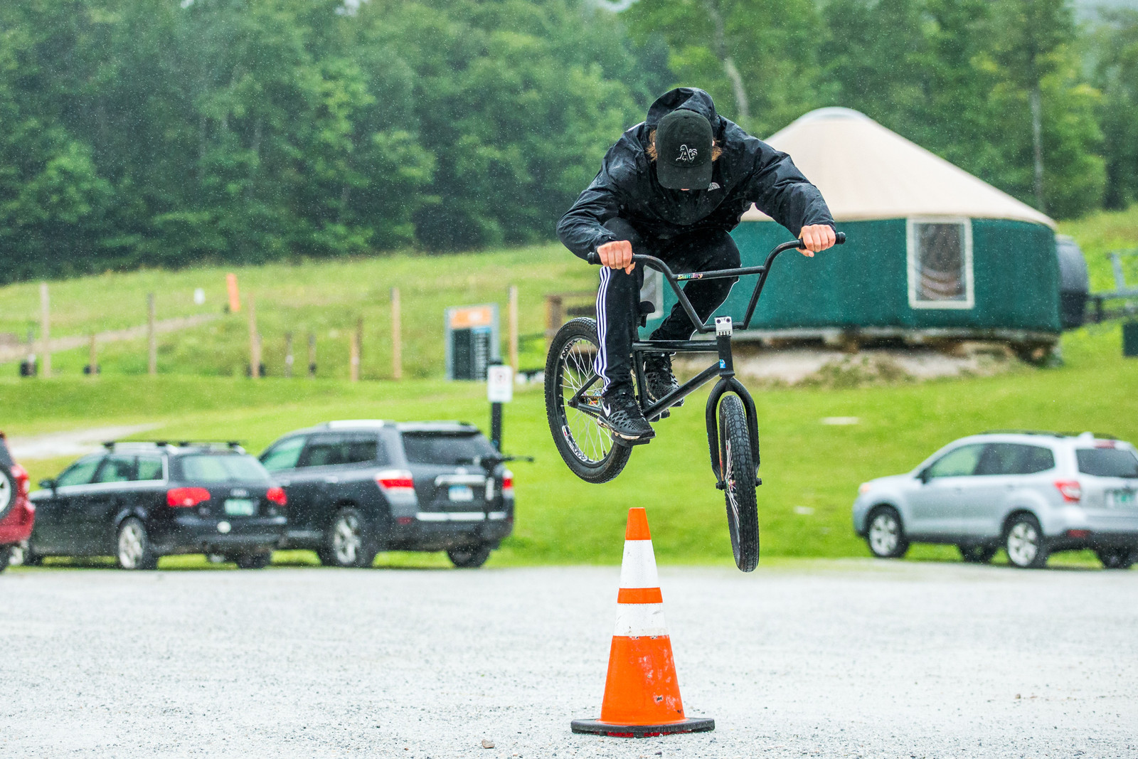 Parking lot shenanigans in the rain are a staple of any good event. Tanner Stephens gets his hop on.