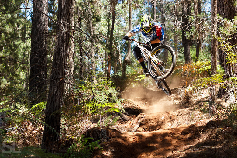 Plow down the steep, loose bombholes section? Nope, send it, with a table for good measure. Ball's got balls. - Chamakazi - Mountain Biking Pictures - Vital MTB