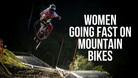 Women Going Fast on Mountain Bikes