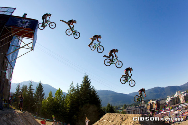 Mike Montgomery blasting a tailwhip off the huge drop at Kokanee Crankworx 2010 (on his hardtail).  He wound up taking 2nd place on the day. - Photo: John Gibson