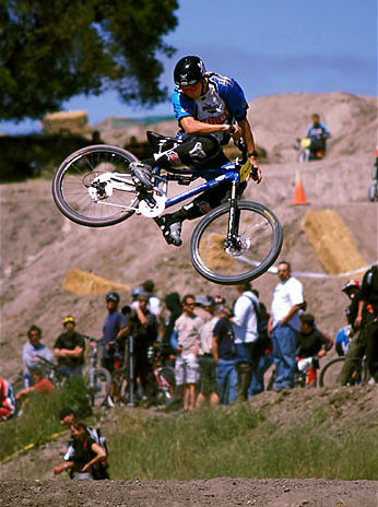 Greg Minnaar competed in 4X and DH events the year he won World Champs. Something that doesn't happen these days. Timeless whip at Sea Otter 2003. photo by gordo