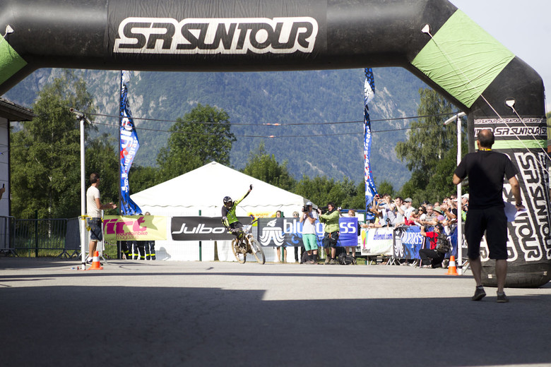 Remy Absalon crossing the finish line in first place.