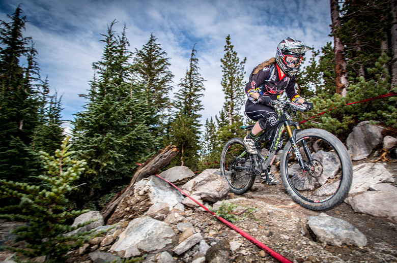 """Liz Miller's determination, focus and strong riding took her to a 2nd place Kamikaze finish and 1st overall expert women. Liz is eager for the 2015 season, saying """"CES has unlimited potential with new venues to explore and sweet singletracks to shred. So stoked for what awaits."""" (Called To Creation)."""