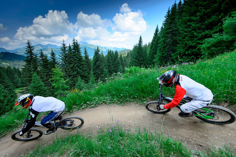 The wide variety of riding in Les Gets, France—Cross-country, 4-Cross, North Shore trails, and a kid zone with Mini Jump Park and Pump Track—will make the resort the perfect second stop for the Crankworx World Tour. © OT Les Gets/Nico Joly