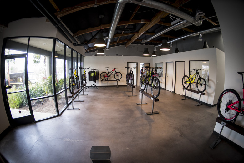 The showroom floor displaying close to COMMENCAL's full range of bikes, from kids bikes to DH rigs.