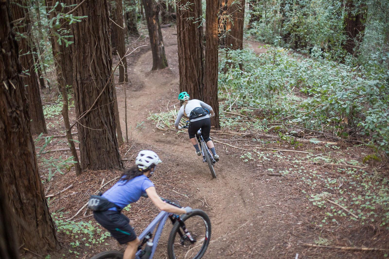 Juliana-SRAM pro team riders Kelli Emmett and Sarah Leishman on the Emma McCrary Trail in Santa Cruz, CA. Photo: Mike Thomas/SCB