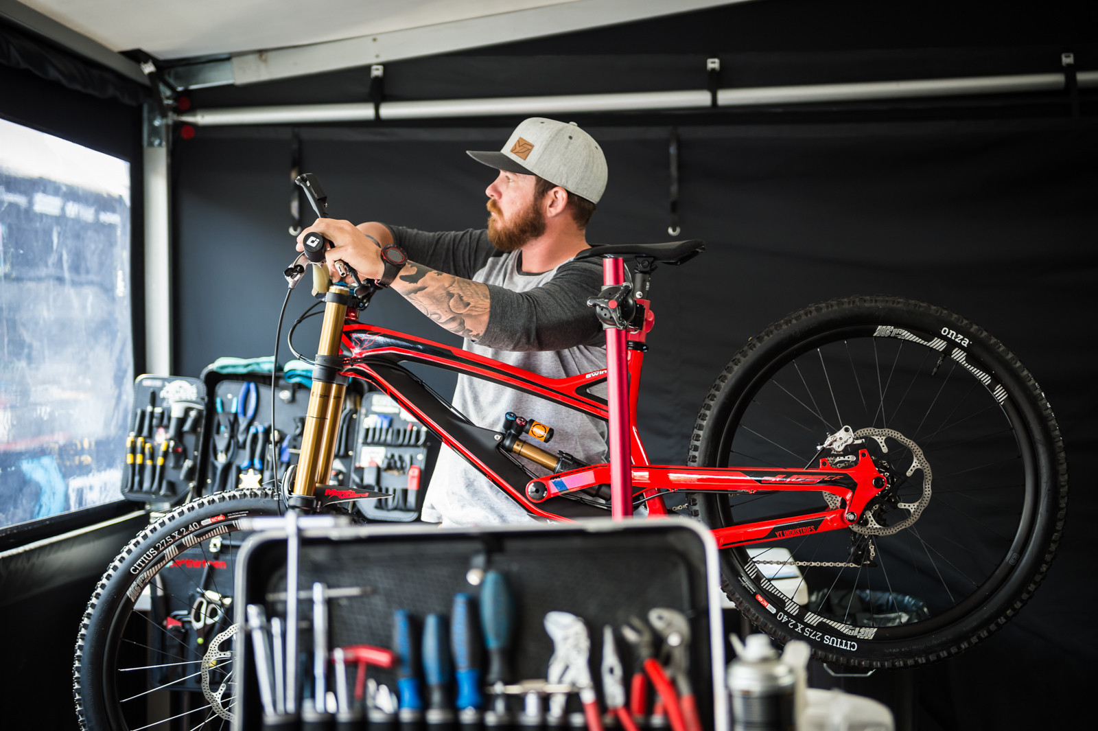 Gwin's mechanic, John Hall, with the new YT all built up for the first 2016 World Cup in Lourdes, France. Onza tires are present here, but we all know Gwin went on to win with sharpied Maxxis tires.