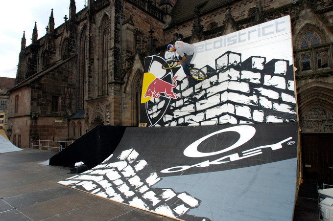 Gee Atherton sending it at the urban slopestyle contest Red Bull District Ride in 2006
