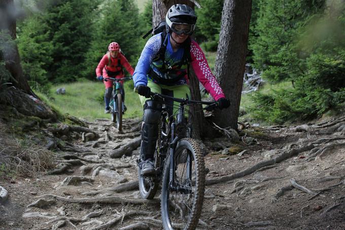 Nina Schwab powering through a rooty section.