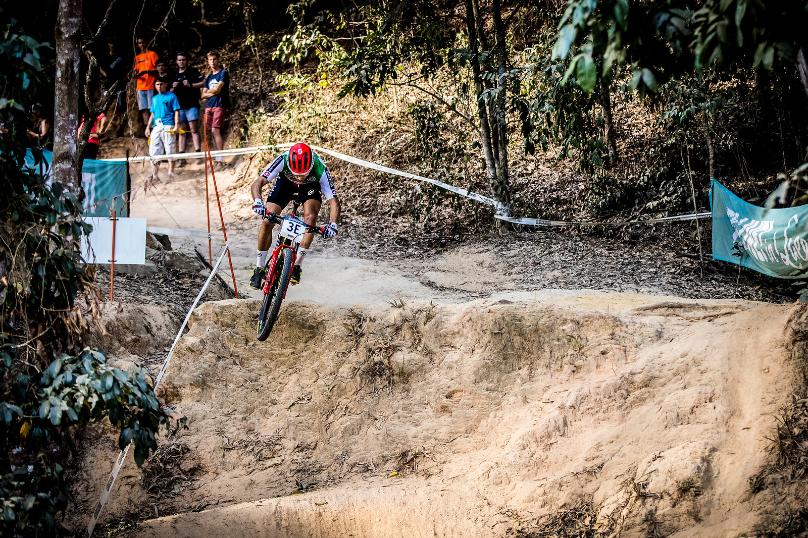 Nino Schurter anchoring the last leg in the team relay and making the pass for gold for Switzerland.