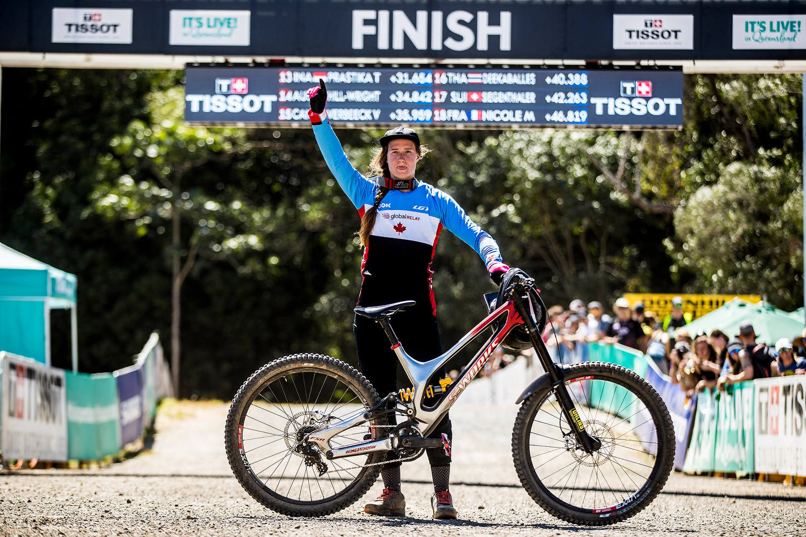Miranda with her World Champs-winning bike at Cairns.