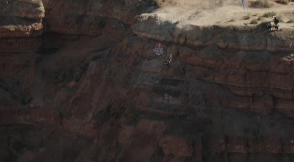 That's Zink flipping in there. A human. On a bicycle. Upside-down. Off a cliff. #WTF