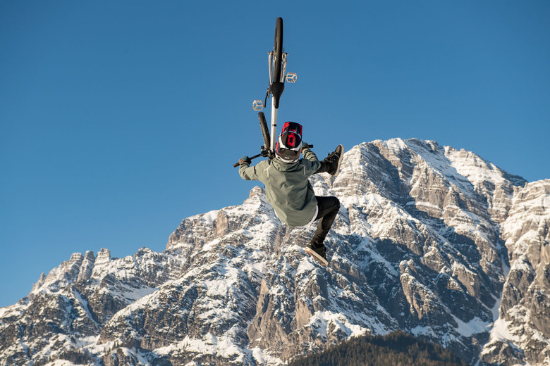 """Simon is doing a Flip Whip in front of the Leogang """"Steinberge""""."""