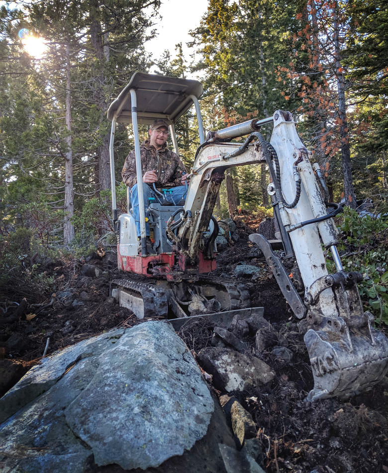 Trail Boss, Henry O'Donnell, uses Old Wobblyin a particularly rocky section of Mills Peak Trail.