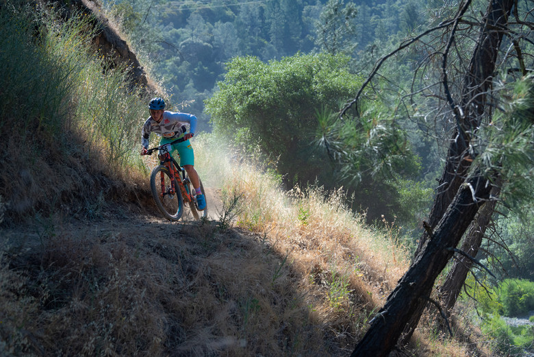 Expert Boys first place winner Jake Snow on the tight Confluence Trail above the American River.