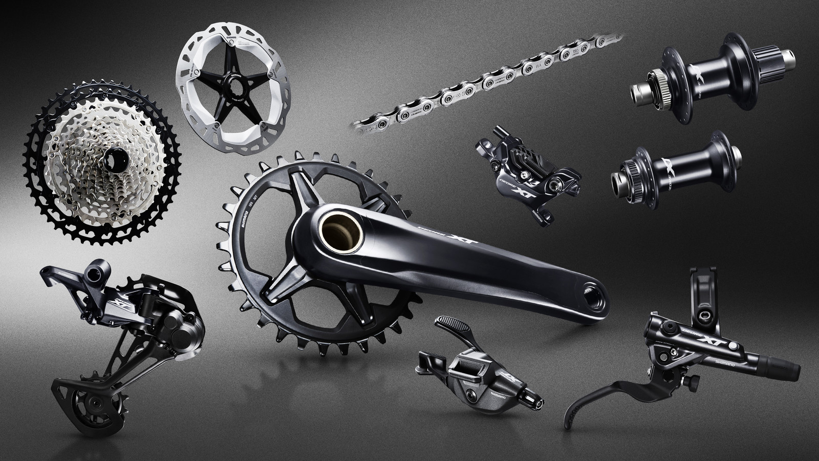 6e7a9f66ed5 Shimano's new XT group is tied together with a classy, fast, polished black  finish. The clean, smooth styling gives the group a cohesive look and feel  ...