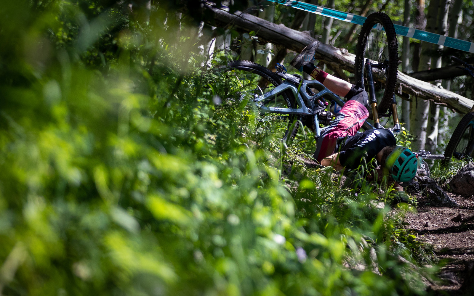 Unfortunately the backcountry single track took some victims, fortunately, Sarah Smith picked herself up and kept charging after this mishap.