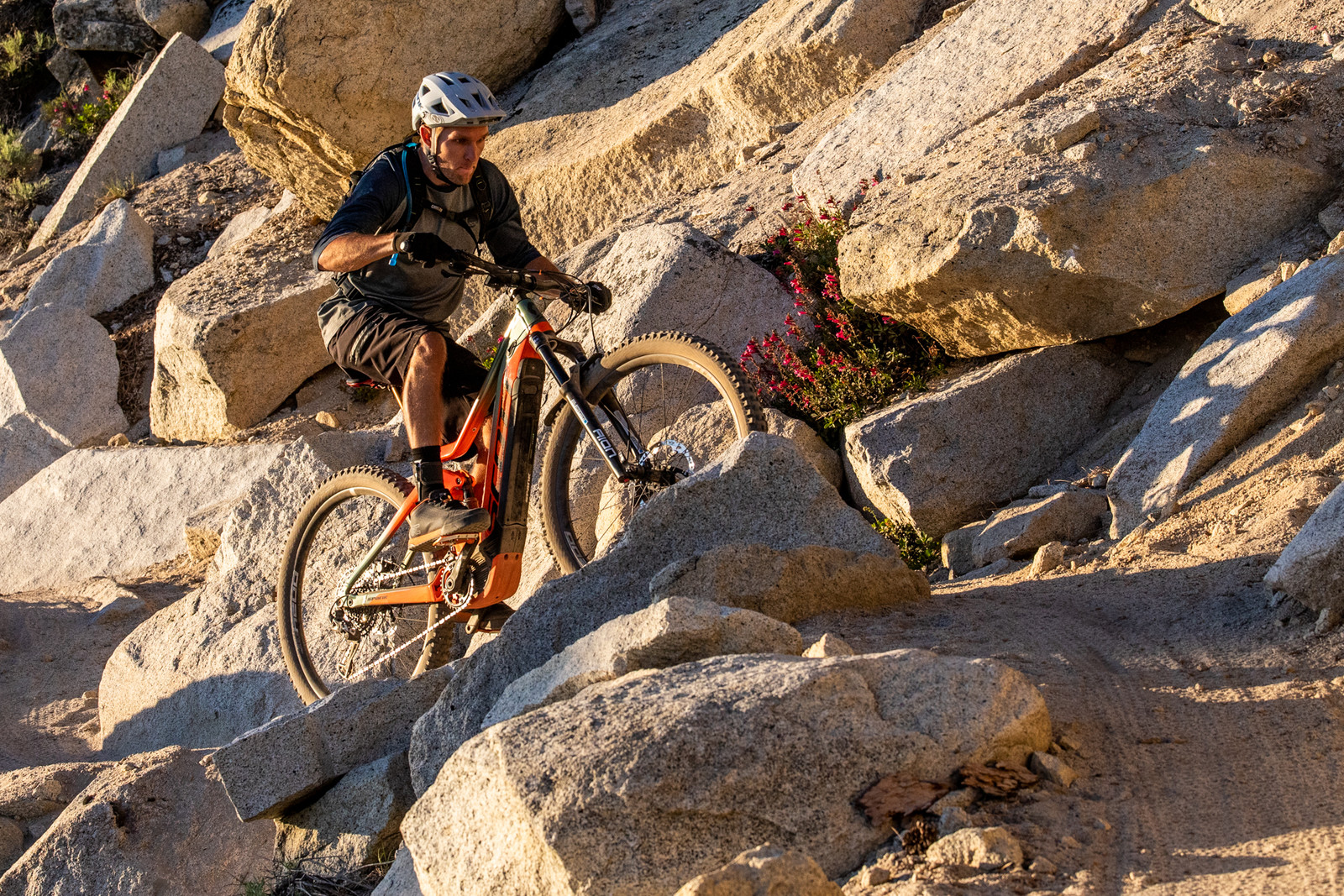 Cautiously pushing his limits on technical climbs, pedal assist making all the difference.