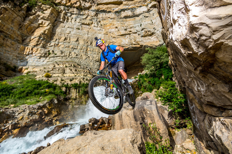 Kenny Belaey riding alongside Afqa waterfall in Lebanon
