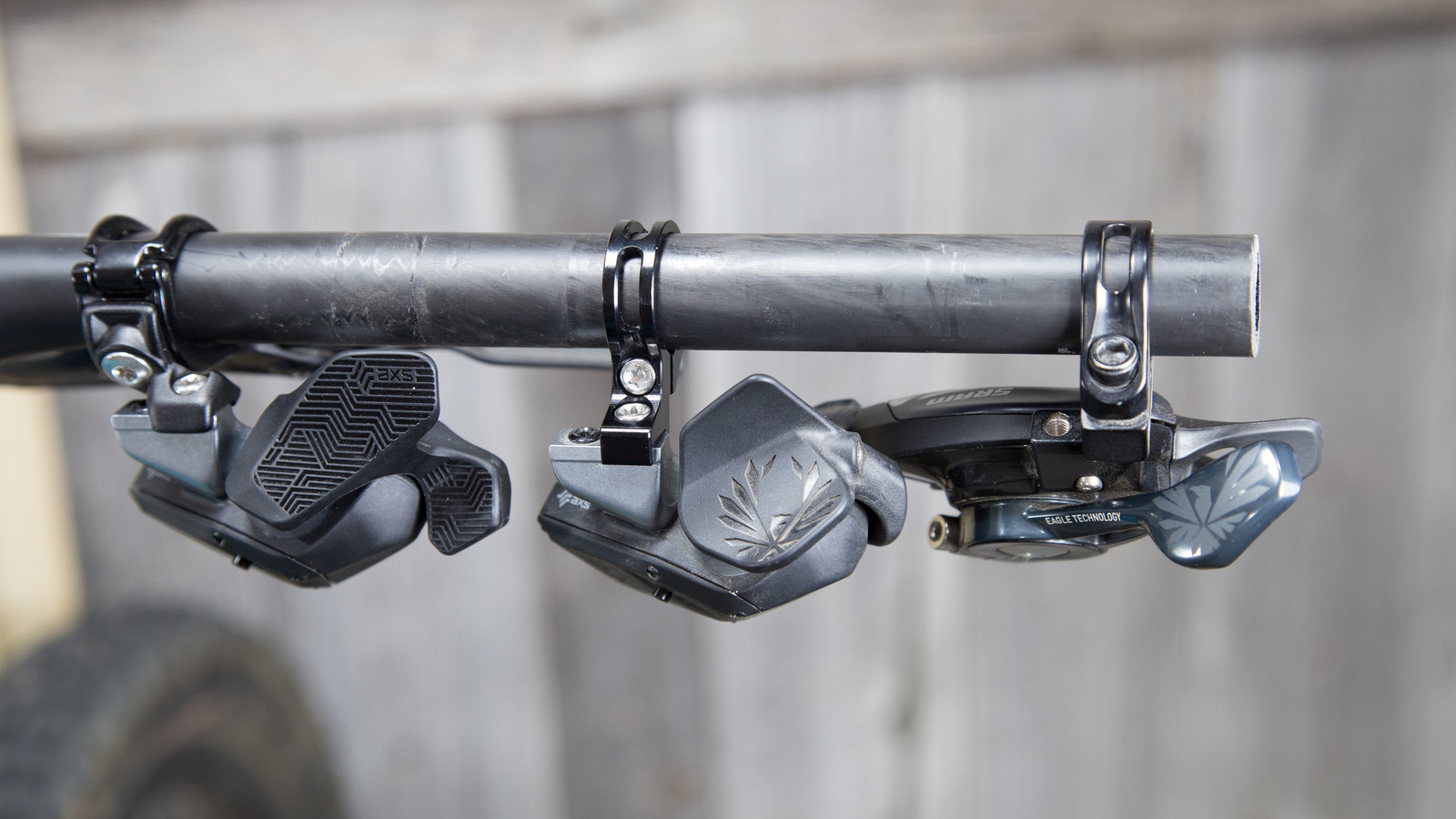 Left-to-right: AXS controller with new rocker, AXS controlller with original rocker and Discrete Clamp, SRAM X01 cable-actuated shifter.