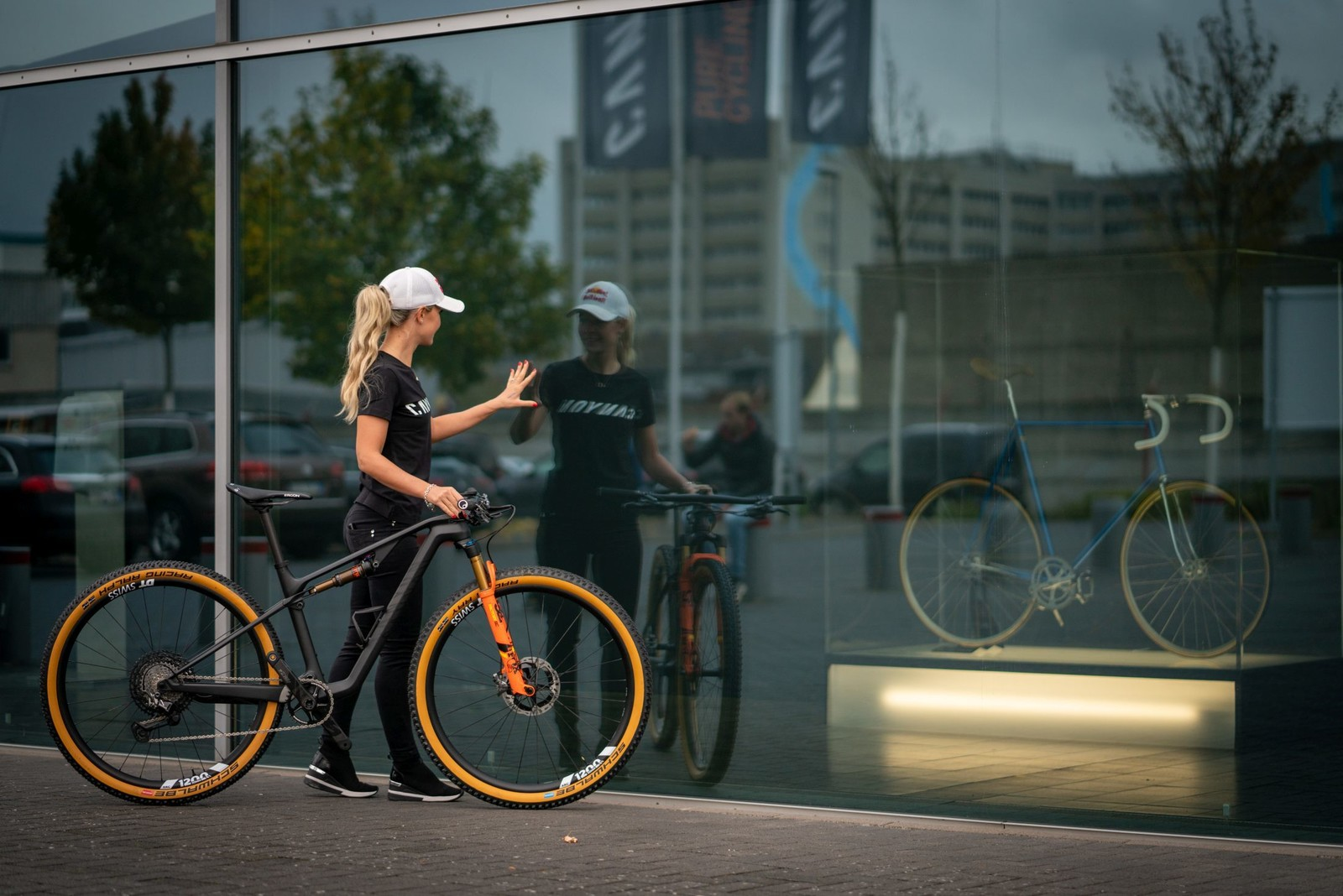 XCO star Emily Batty and the track bike of Canyon founder Roman Arnold. Pictured at the Canyon HQ Showroom, Koblenz, Germany.