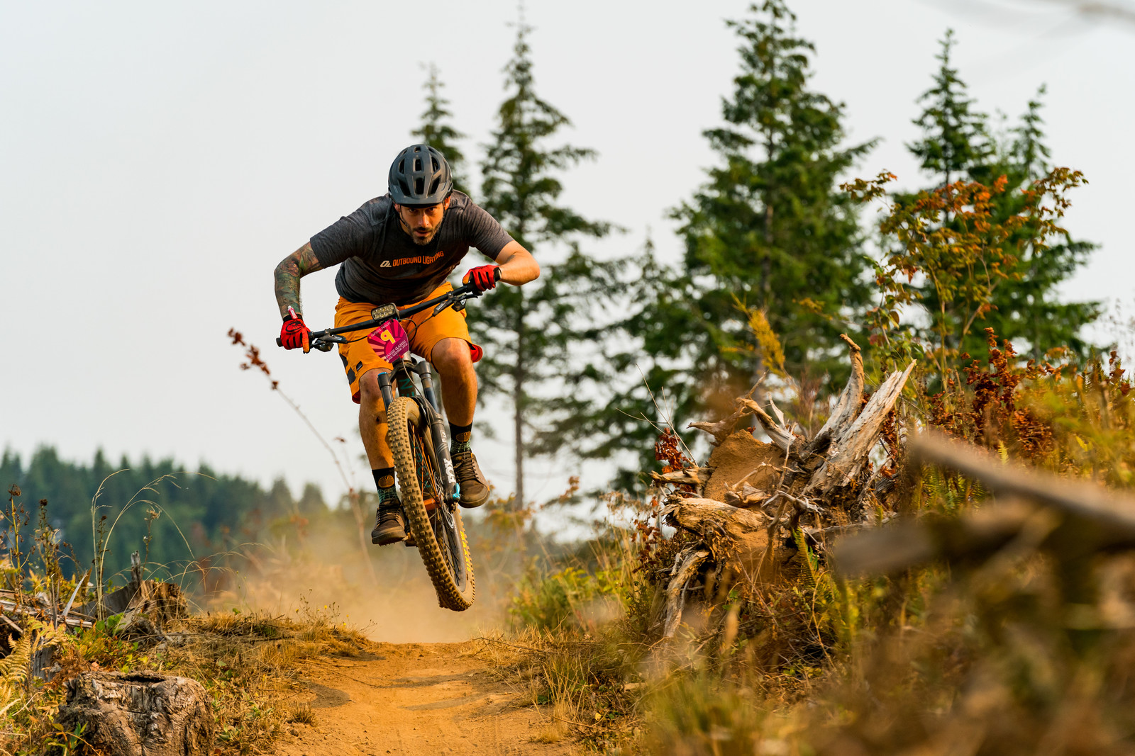 """Tom """"Danger"""" Place of Outbound Lighting on Stage 1 of Little Larch. Proving the lights are so small why not just leave them on your bike... though with the smoke he might have actually used it on course."""