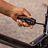 Kailey using Jarod Hanson's Kershaw multi-knife in a pinch