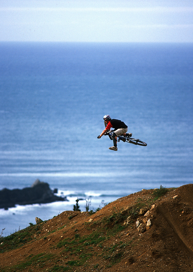 Pro Rider Photo Gallery, Cam McCaul - One-footed Table over the Pacific, 2003 - Cam McCaul, Pro Rider Photo Gallery - Mountain Biking Pictures - Vital MTB