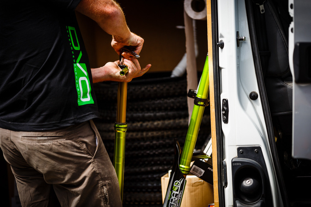 Tom Rogers Wrenching on Cedric's DVO Emerald Fork - PIT BITS: 2013 Andorra World Cup - Mountain Biking Pictures - Vital MTB
