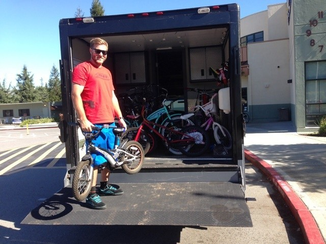 Austin loading fixed bikes to take to the local non-profit's headquarters.
