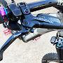 SRAM Code R brakes; Ergon GE-1 EVO grips w/custom color combo; Knog Oi trail bell; Titanium oil slick Matchmaker bolt.