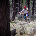 Mikey Haderer busts a power wheelie on Ben's trail in Bend, OR